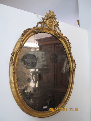 Late 19th Century oval gilt mirror